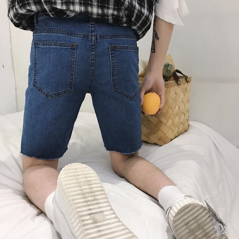 裤口毛边牛仔短裤