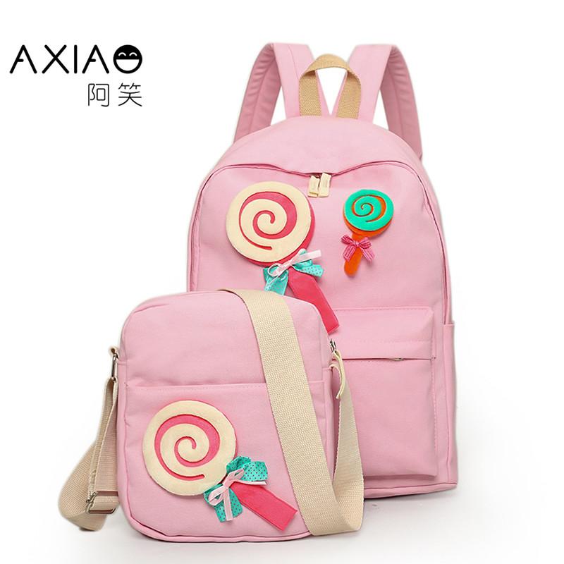 阿笑双肩包儿童书包女初中小学生韩版帆布学院风棒棒糖旅行休闲大容量图片